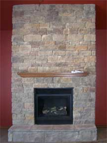 stone fireplace with wood mantel