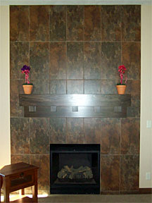 custom tile fireplace with dark wood mantel