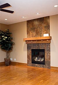 custom tile fireplace and wood mantel
