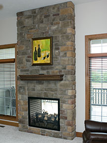 see through stone fireplace