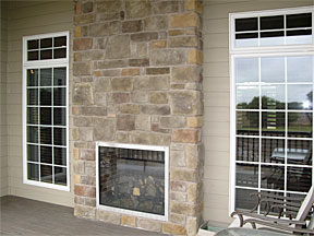 inside/outside stone fireplace