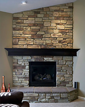 stone fireplace with stone hearth