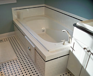 master bath with custome tile and whirlpool tub