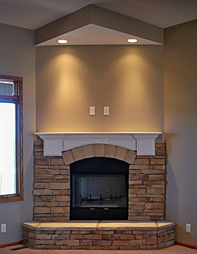 stone fireplace with custom mantel