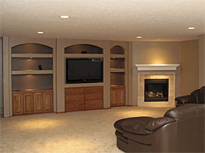 basement remodel with fireplace and built-ins