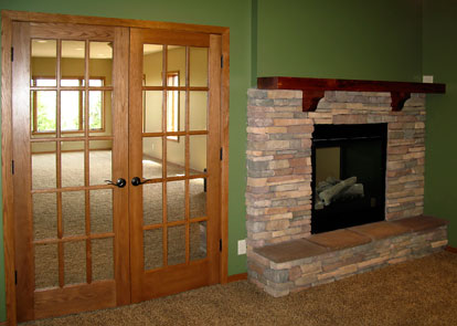 office with french doors and see-through fireplace